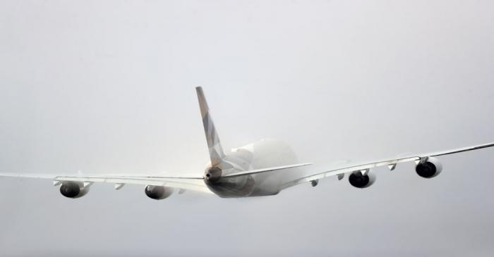 FILE PHOTO: Etihad aircraft disappears into the clouds as it takes off from Heathrow Airport in