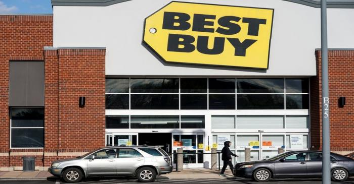 FILE PHOTO: People wait for purchases outside of a Best Buy store due to the outbreak of