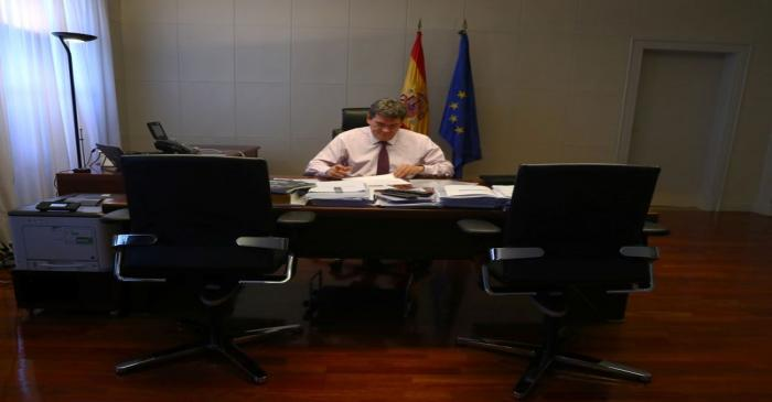 Spain's Social Security Minister, Escriva, works in his office during an interview with Reuters