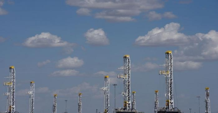 FILE PHOTO: Oil rigs in a storage facility wait to be transported to the oil field in Midland