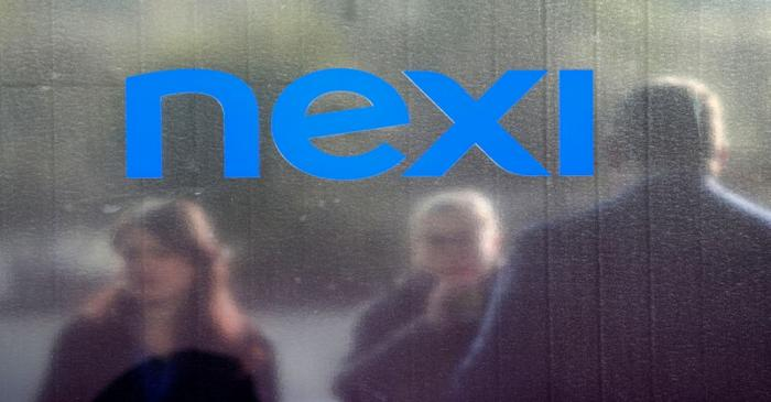 People stand outside the Italian payments group Nexi's headquarters in Milan in Milan