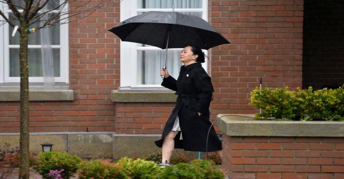 FILE PHOTO: Huawei Chief Financial Officer Meng Wanzhou leaves her home to attend her