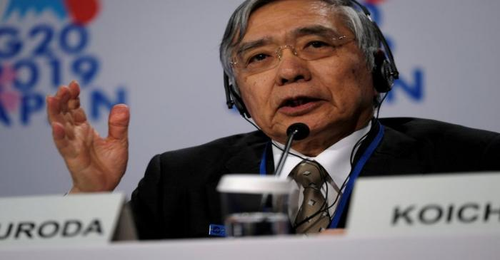 FILE PHOTO: Bank of Japan Governor Haruhiko Kuroda takes questions from reporters at the annual
