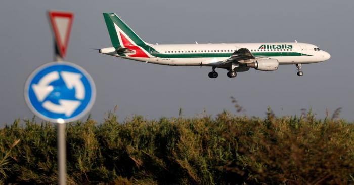 FILE PHOTO: An Alitalia Airbus A320 airplane approaches to land at Fiumicino airport in Rome,