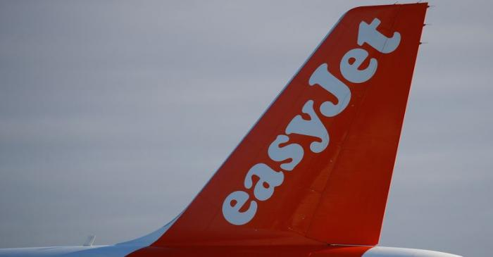 The company logo is seen on the tail of an Easyjet plane at Manchester Airport in Manchester