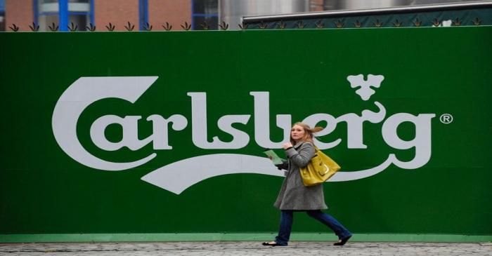 A woman walks past the Tetley's brewery in Leeds, northern England