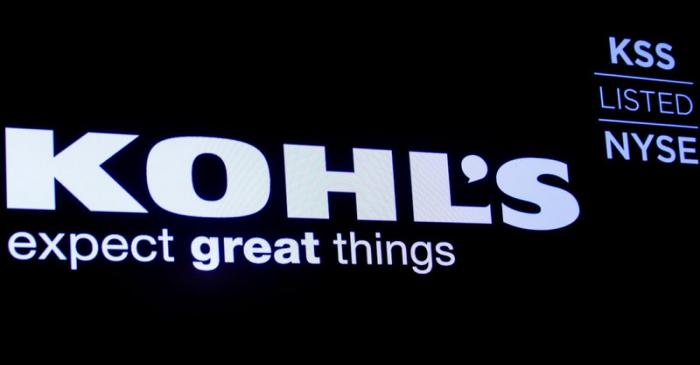 The logo and trading informations for Kohl's  is displayed on a screen on the floor at the NYSE