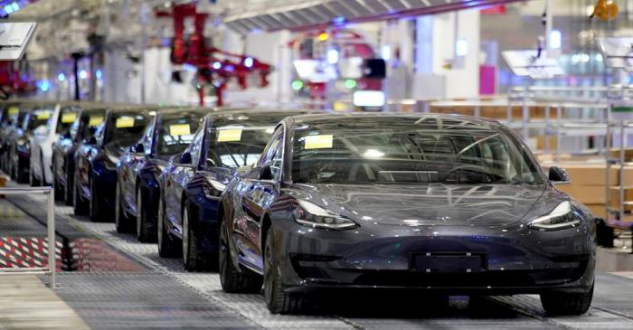FILE PHOTO: Tesla China-made Model 3 vehicles are seen during a delivery event at its factory