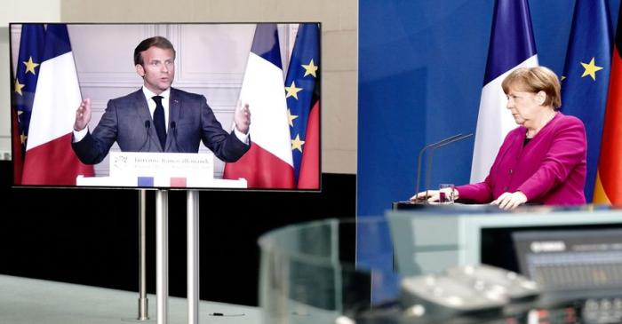 FILE PHOTO: German Chancellor Angela Merkel holds a joint video news conference with French