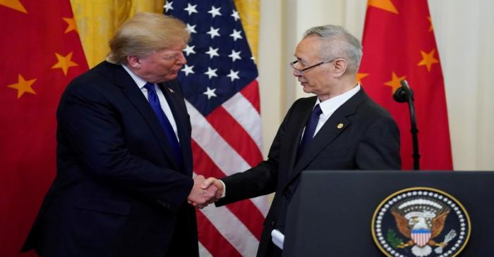 FILE PHOTO: U.S. President Donald Trump shakes hands with Chinese Vice Premier Liu He during