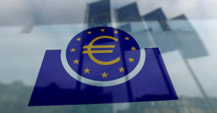 FILE PHOTO: Specialists work on a crane in front of the European Central Bank (ECB) in
