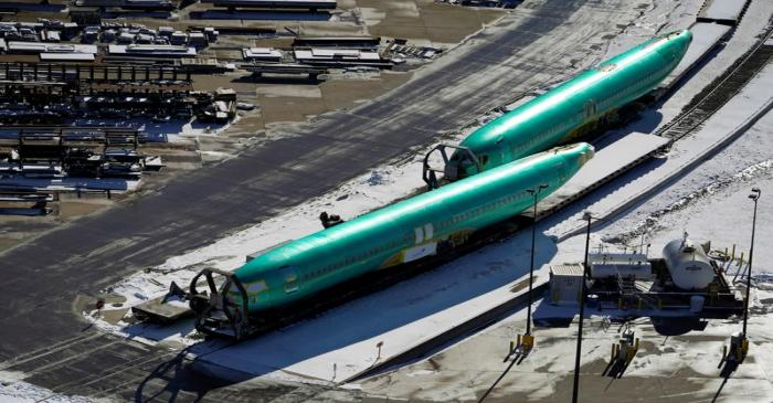 Airplane fuselages bound for Boeing's 737 Max production facility await shipment on rail