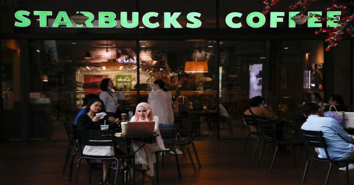 Customers dine in a Starbucks store, amid the coronavirus disease (COVID-19) outbreak in