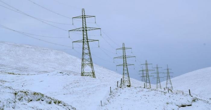 FILE PHOTO: Electricity pylons carrying the Beauly-Denny powerline are seen close to the A9