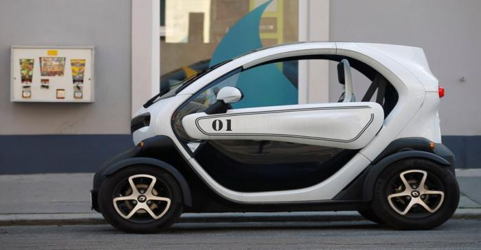 A Renault Twizy battery-powered electric car is parked on a street in Vienna