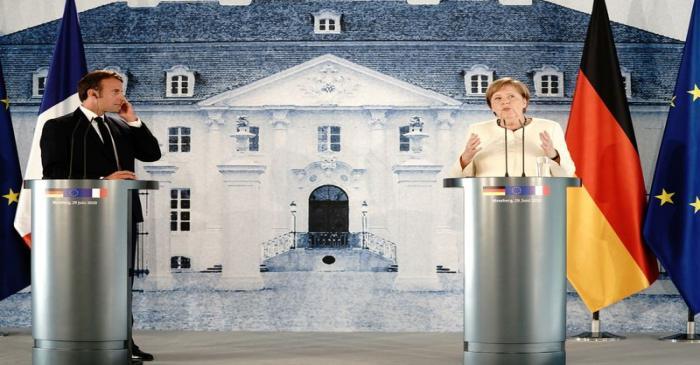 German Chancellor Angela Merkel and French President Emmanuel Macron meet at Meseberg castle