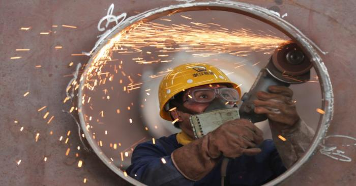 Employee works on a production line manufacturing steel structures at a factory in Huzhou