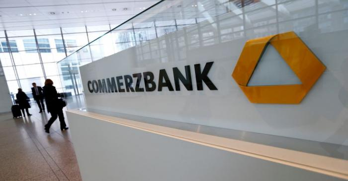 Visitors arrive at Commerzbank's headquarters before the bank's annual news conference in