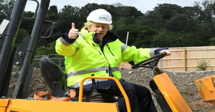 Britain's Prime Minister Boris Johnson gestures visits the Speller Metcalfe's building site in