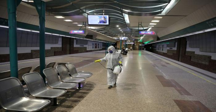 Worker sprays disinfectant in Serdika metro station in Sofia