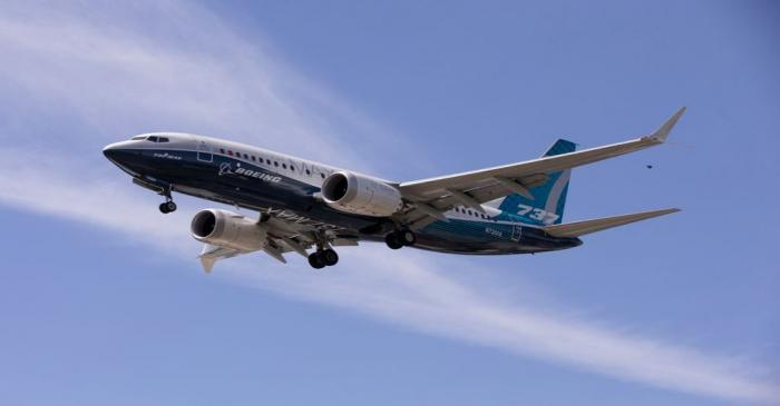 A Boeing 737 MAX airplane lands after a test flight at Boeing Field in Seattle
