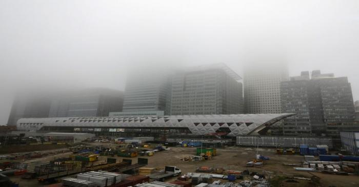 A low fog engulfs the skyscrapers of the financial district of Canary Wharf