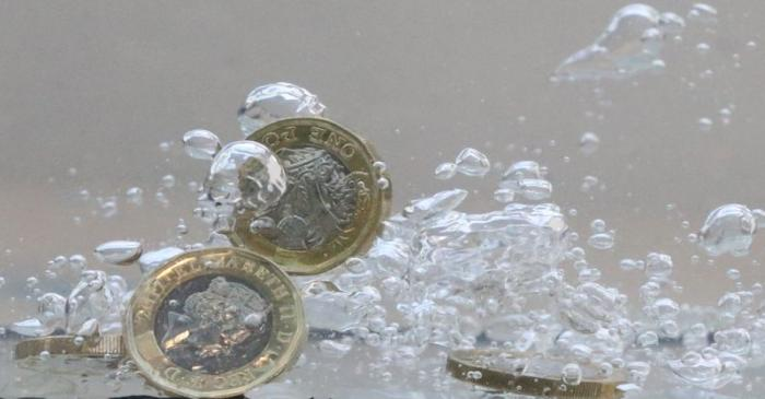 UK pound coins plunge into water in this illustration picture