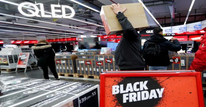 People shop during Black Friday deals at consumer electronics retailer Media Markt near