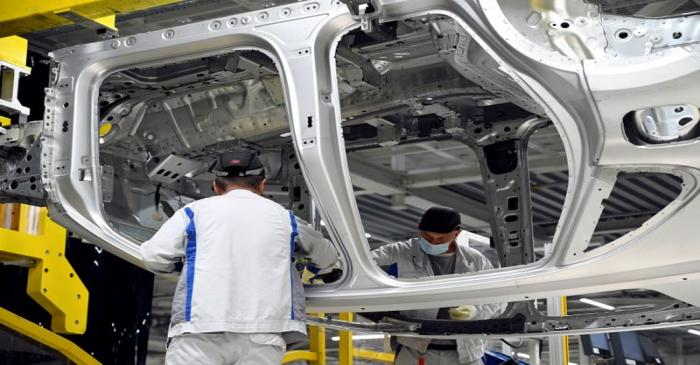 FILE PHOTO: Employees work on an assembly line as the Volkswagen construction plant reopens