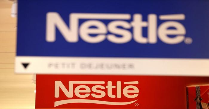 FILE PHOTO: Nestle logos are pictured in the supermarket of Nestle headquarters in Vevey