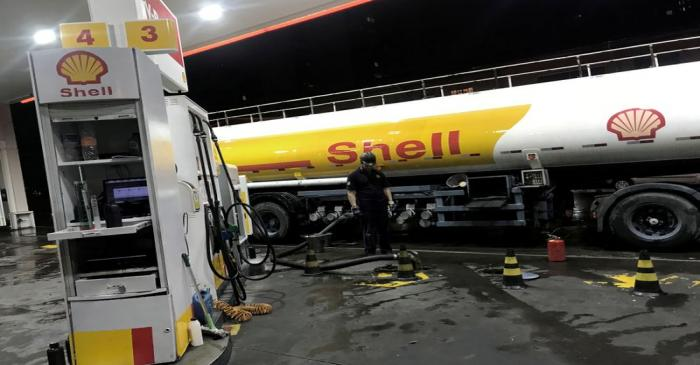 FILE PHOTO: Oil tank truck fills the pumps at a Shell petrol station in Sao Paulo