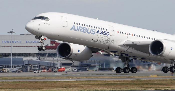 FILE PHOTO: An Airbus A350 takes off at the aircraft builder's headquarters in Colomiers near