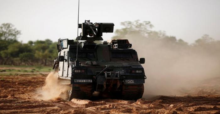 FILE PHOTO: French soldiers patrol in an all-terrain armoured vehicle BvS10 produced by BAE