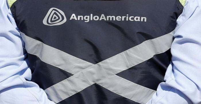 FILE PHOTO: Logo of Anglo American is seen on a jacket of an employee of the Los Bronces copper