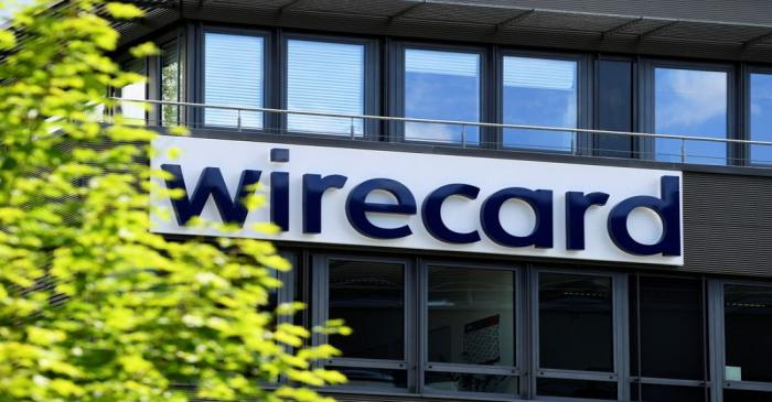 FILE PHOTO: The logo of Wirecard AG at its headquarters in Aschheim