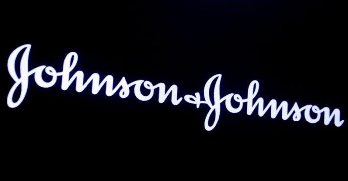 The company logo for Johnson & Johnson is displayed on a screen to celebrate the 75th