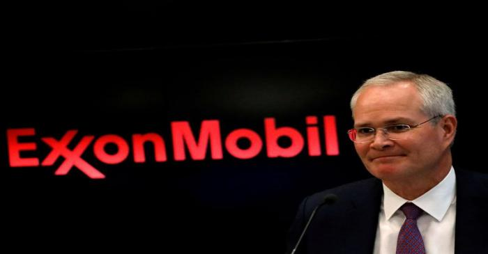 FILE PHOTO: Darren Woods, Chairman & CEO, Exxon Mobil Corporation attends a news conference at