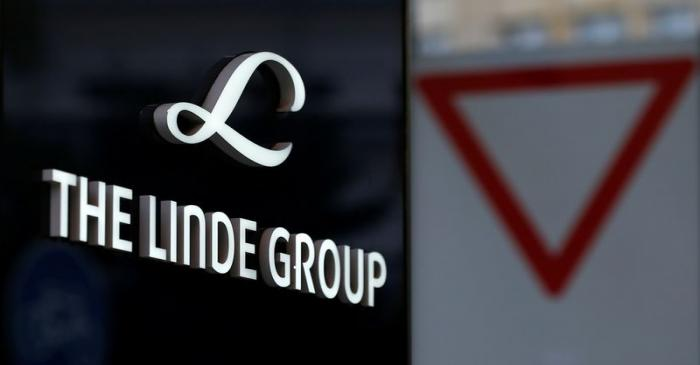 Linde Group logo is pictured close to a traffic sign near its headquarters in Munich