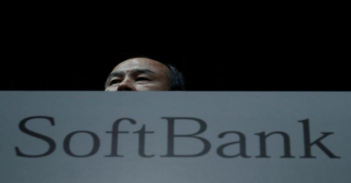 FILE PHOTO: Japan's SoftBank Group Corp Chief Executive Masayoshi Son attends a news conference