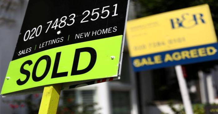 FILE PHOTO: Estate agent boards are displayed outside a property in London