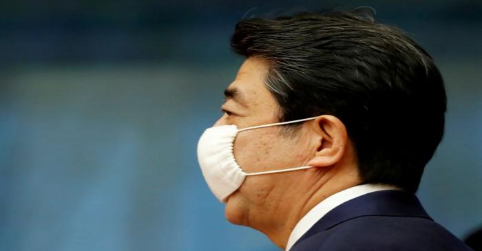 FILE PHOTO: Japan's Prime Minister Shinzo Abe enters a venue for his news conference in Tokyo