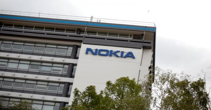 FILE PHOTO: Workers protest over job cuts at Nokia in France