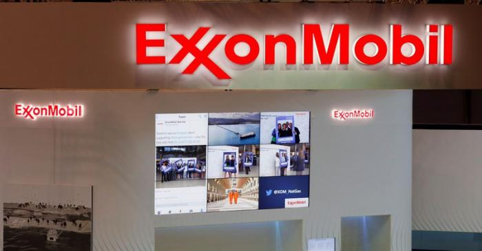FILE PHOTO: Logos of ExxonMobil are seen in its booth at Gastech, the world's biggest expo for