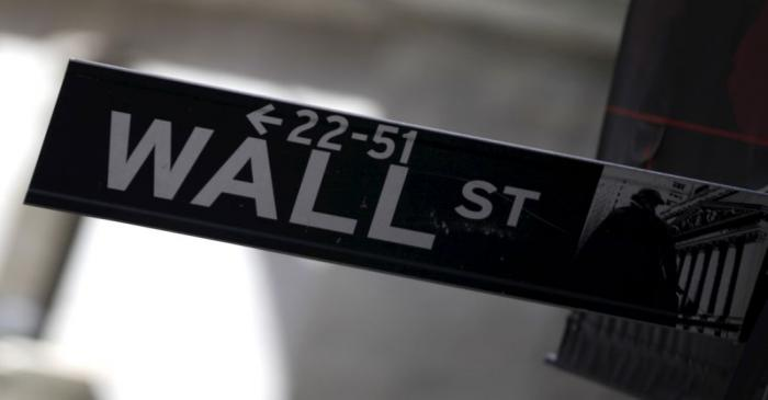 A Wall Street sign is seen in Lower Manhattan in New York