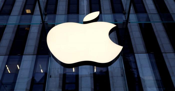 FILE PHOTO: The Apple Inc logo is seen hanging at the entrance to the Apple store on 5th Avenue