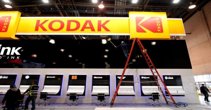 FILE PHOTO: A worker cleans a Kodak booth at the Las Vegas Convention Center in preparation for