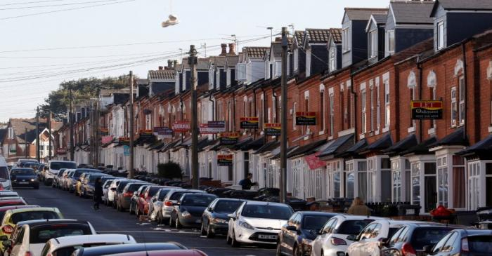 FILE PHOTO: Estate agent's signs hang from houses in the Selly Oak area of Birmingham