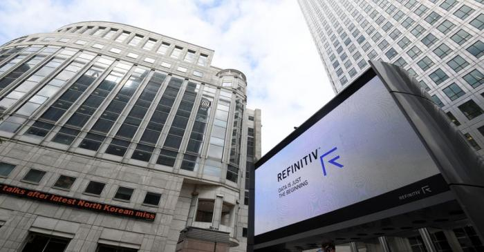 The Refinitiv logo is seen on a large screen in Canary Wharf in London