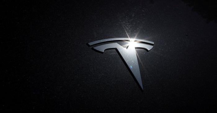 The Tesla logo is seen on a car in Los Angeles