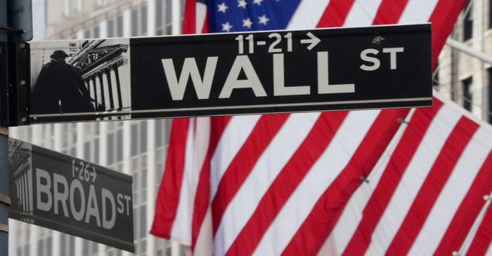 FILE PHOTO: The Wall Street sign is pictured at the New York Stock exchange (NYSE) in the